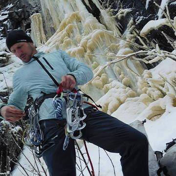 NW Alpine Ambassador Adam Dailey Racking up at Ice Climb
