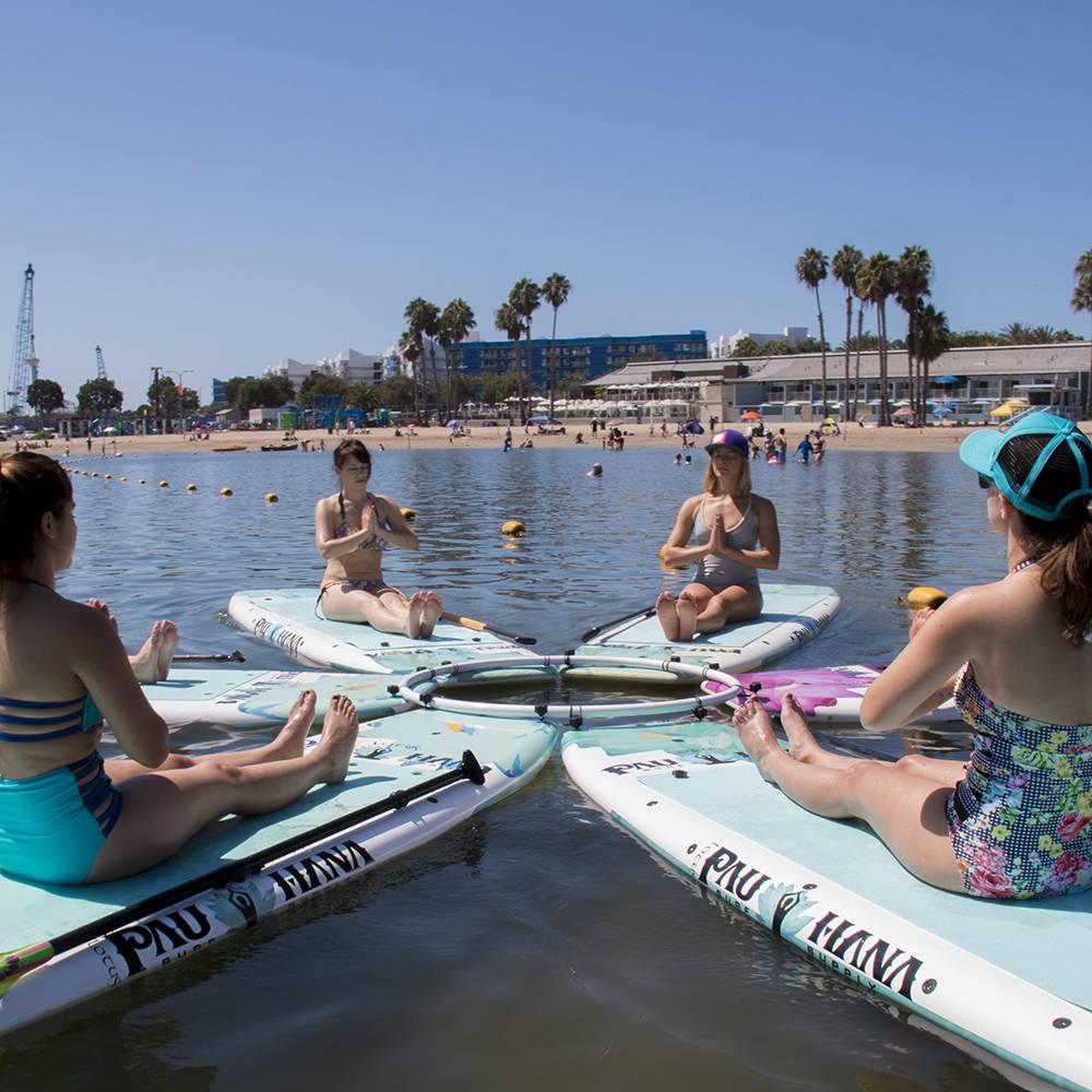 Yoga class with the Pau Hana Lotus Boards on the water