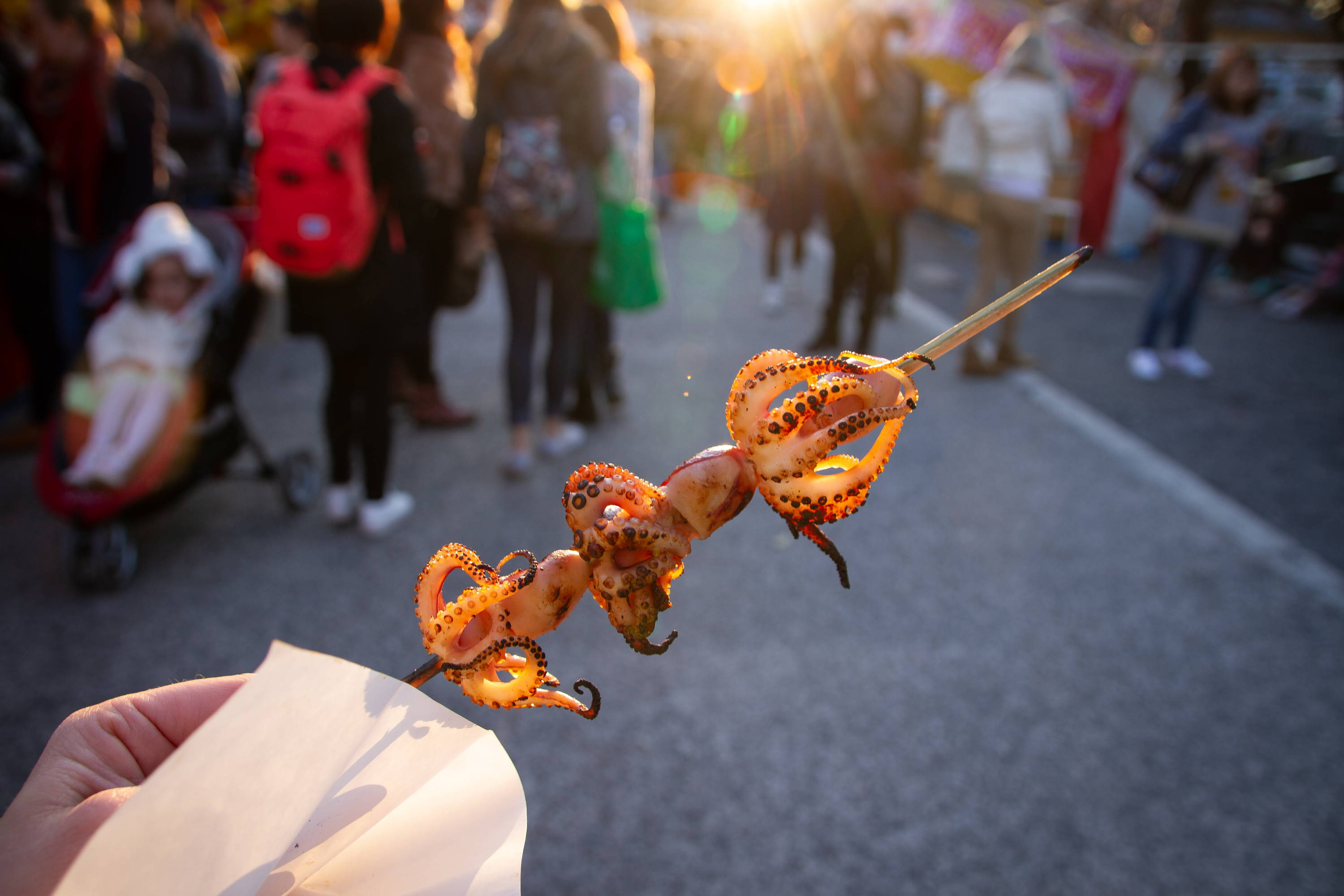 Skewered grilled octopus at a Japanese Festival