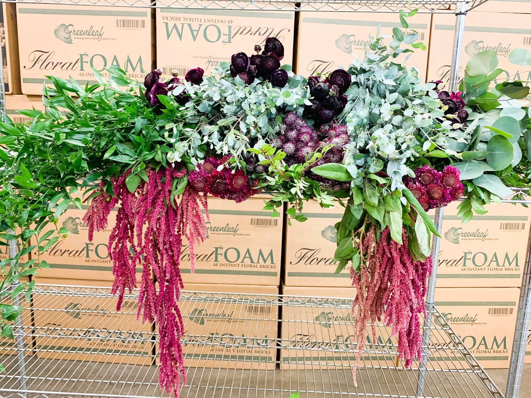 Raspberry scabiosa, purple ranunculus, burg astrantia, eucalyptus, hanging amaranthus
