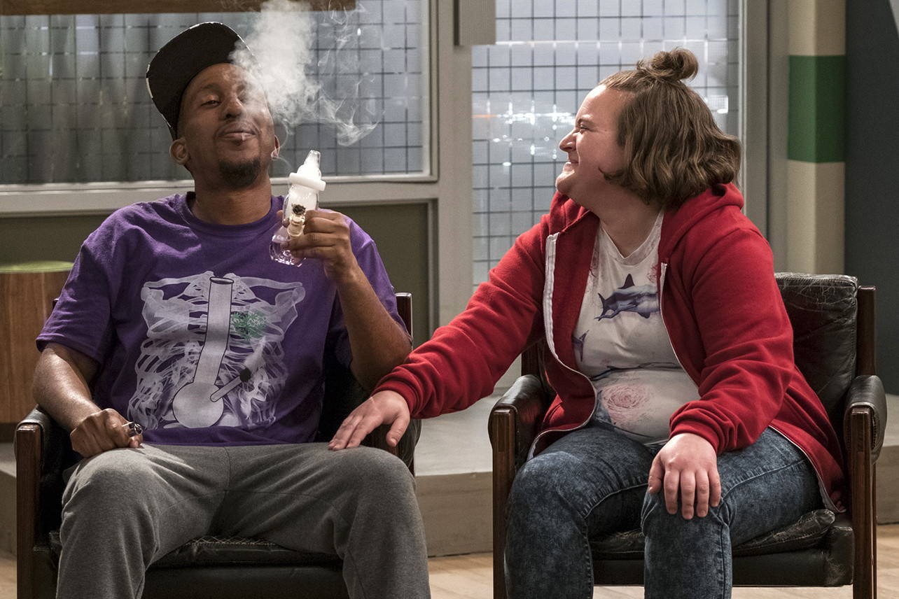 Clip from Netflix show Disjointed of 2 people smoking a bong