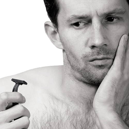 Guy Looking At Disposable Razor