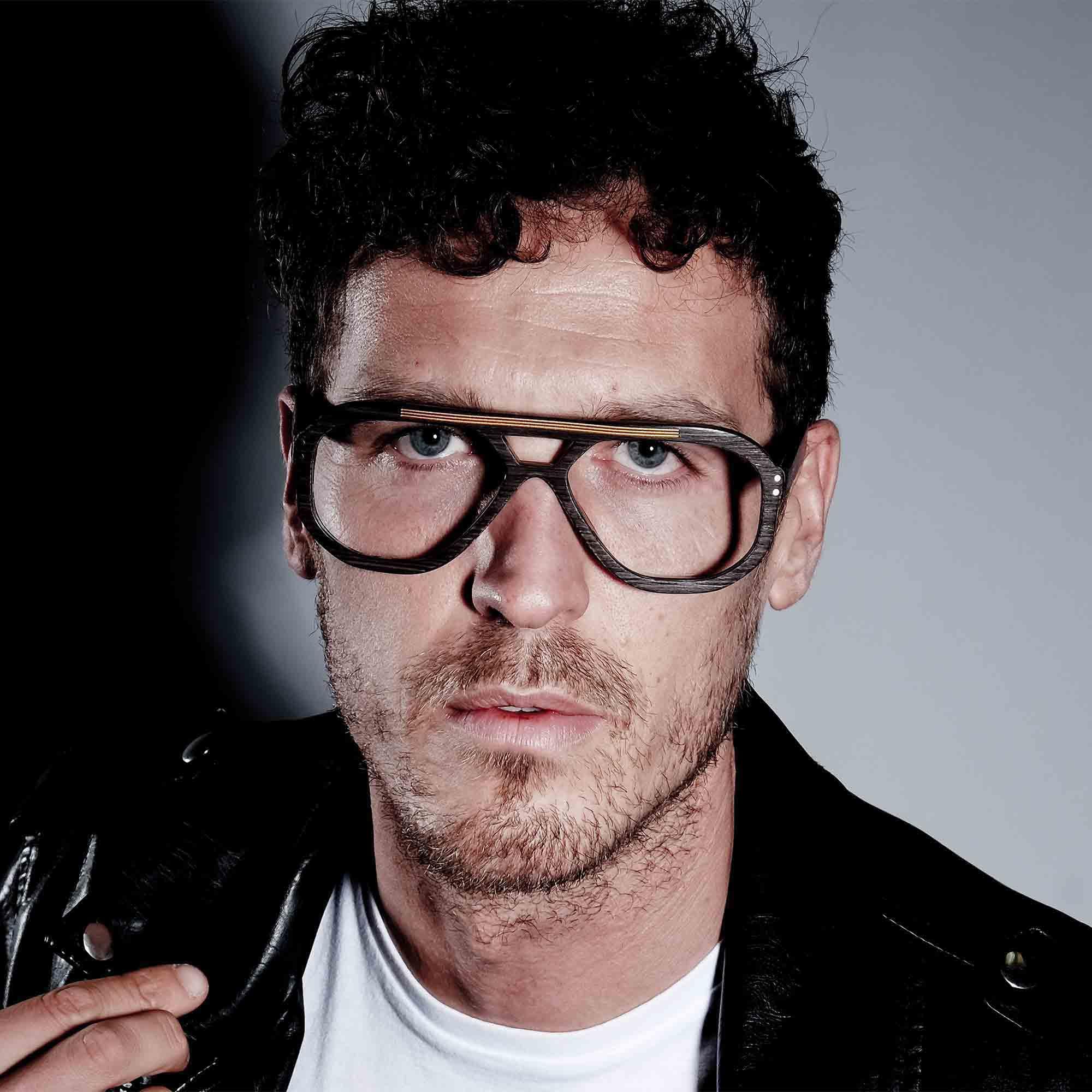 Male model wearing joiuss jim  dark wood navigator glasses