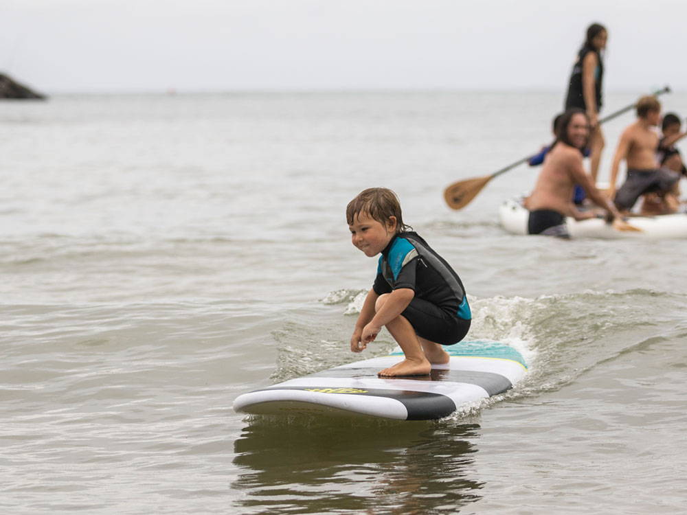 Kid surfing on the Grom SUP