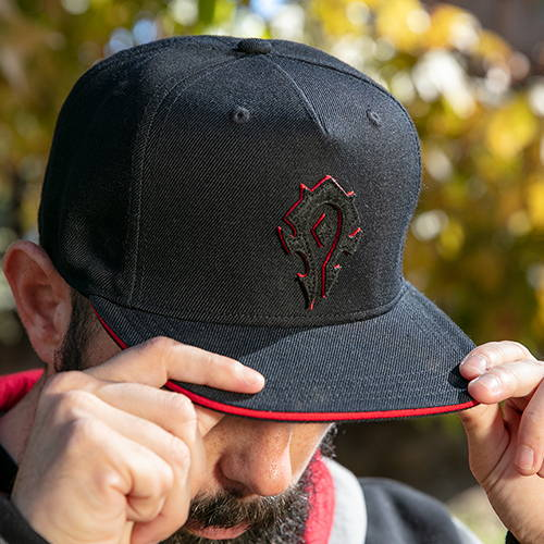 Model wearing the World of Warcraft 15th Anniversary Horde Snapback Hat