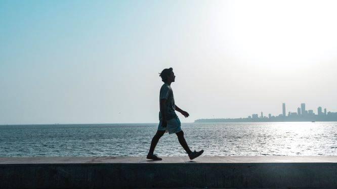 Man Walking Near Sea