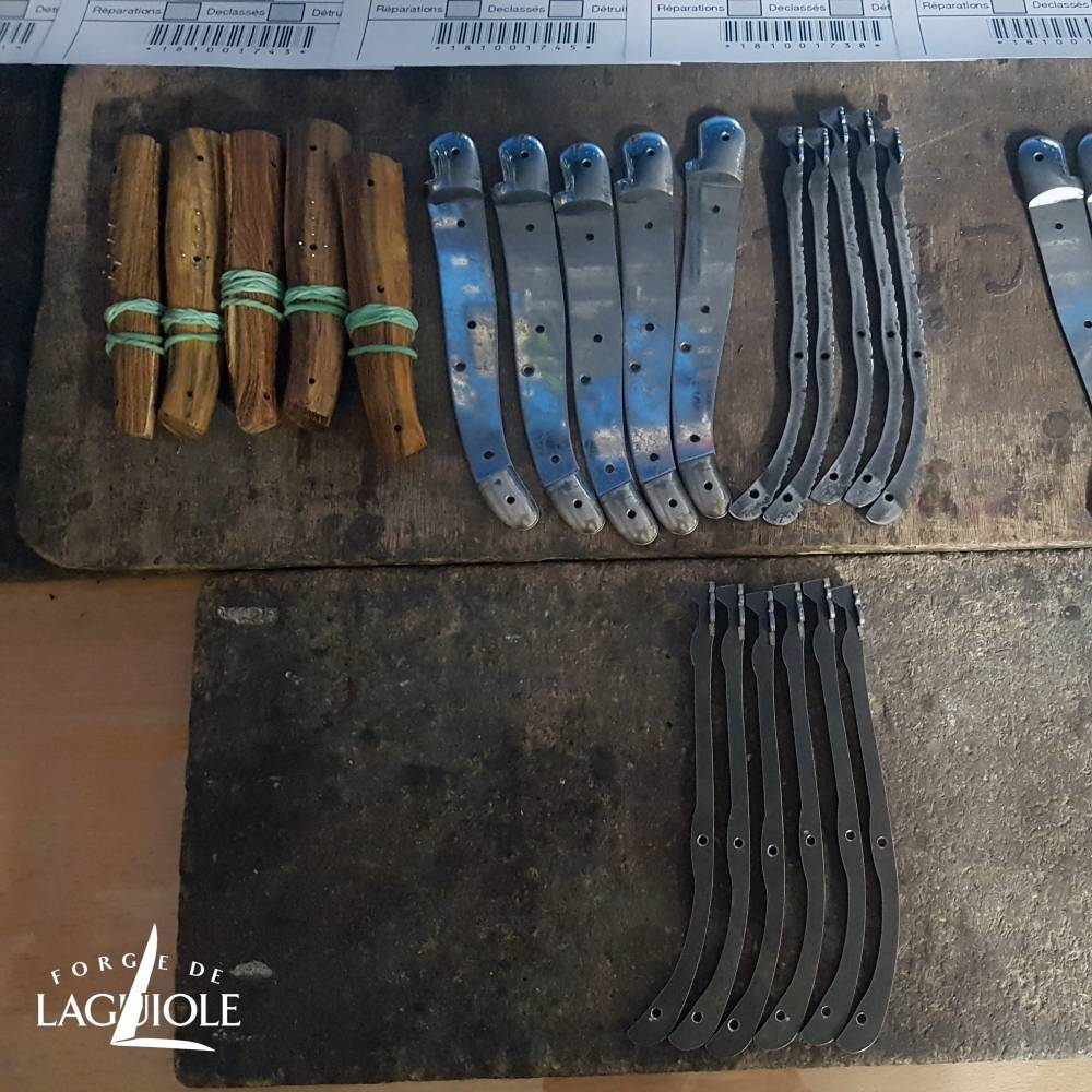 laguiole knives parts on a workbench