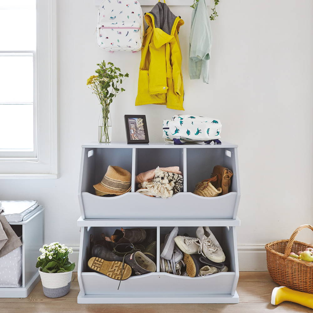 Grey storage unit filled with shoes