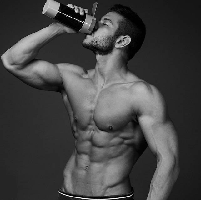 athlete drinking protein shake