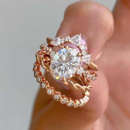 rose gold oval ring and wedding bands