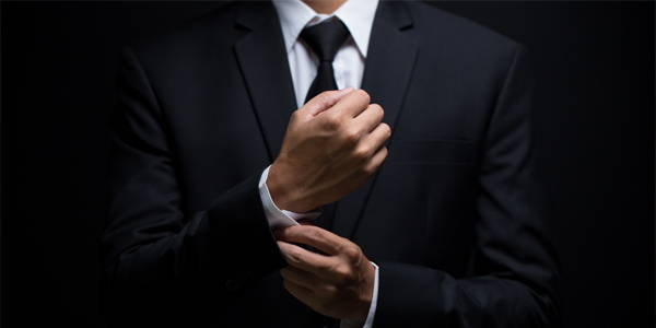 Man adjusting his cufflinks