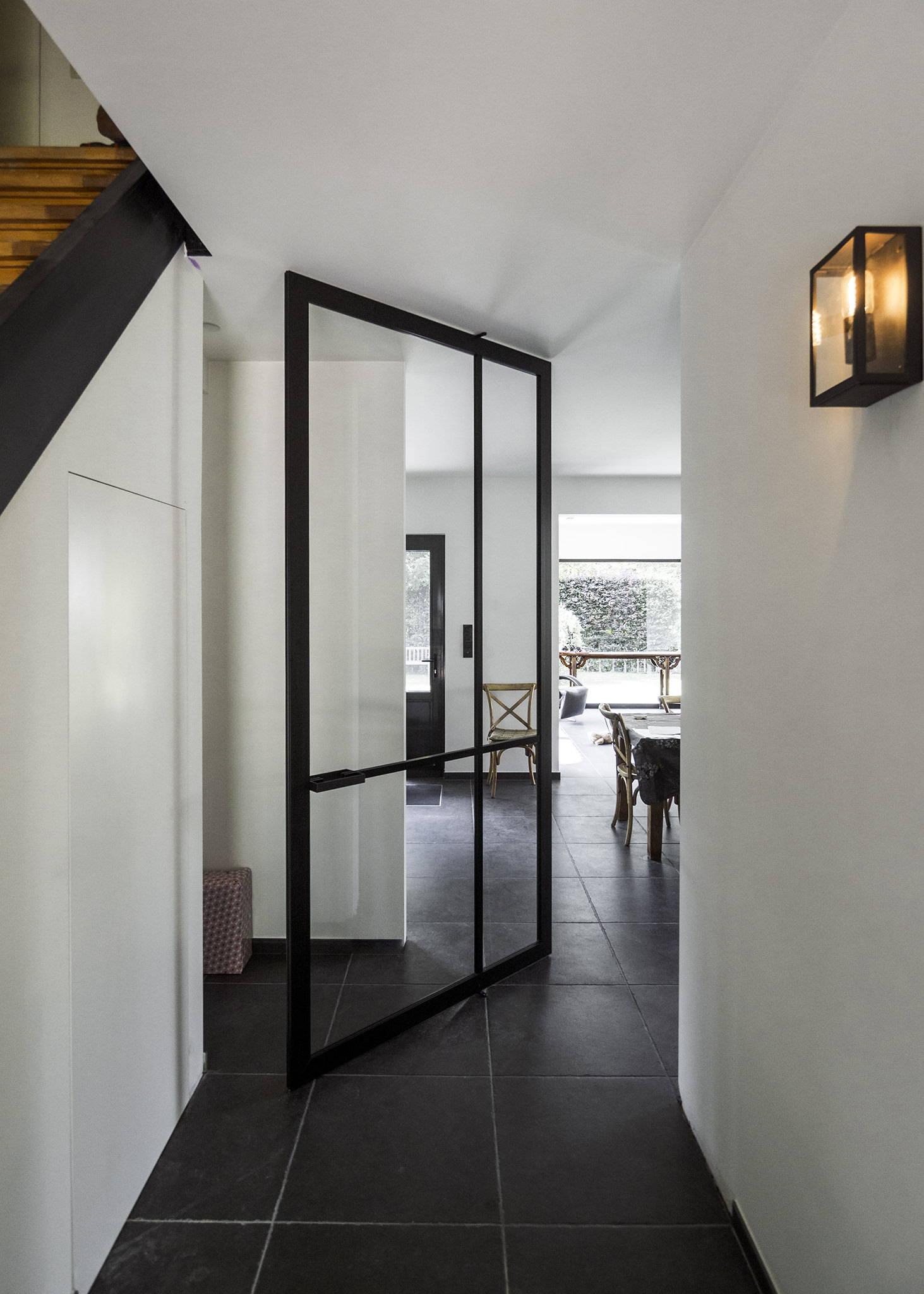 steel look pivot door made from black anodized aluminium