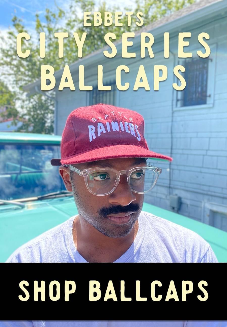 Man wearing red Seattle Rainiers City Series Cap
