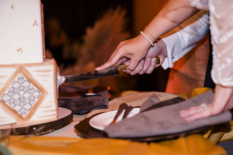 Stems Fresno wedding cake cutting
