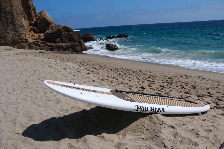 Big EZ Hawaiian SUP on the beach with paddle