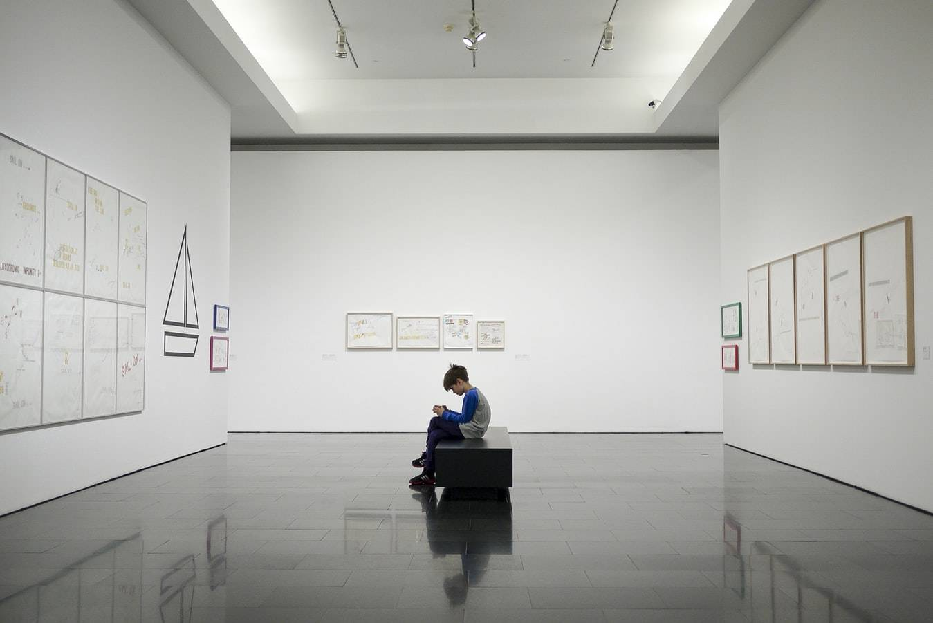 Boy Sitting Near Museum Painting Photo