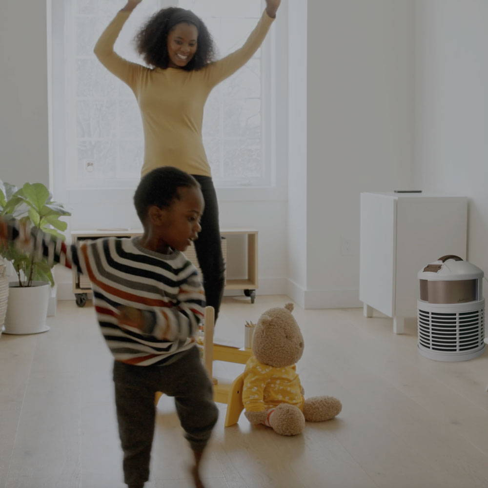 mother son dancing by defender