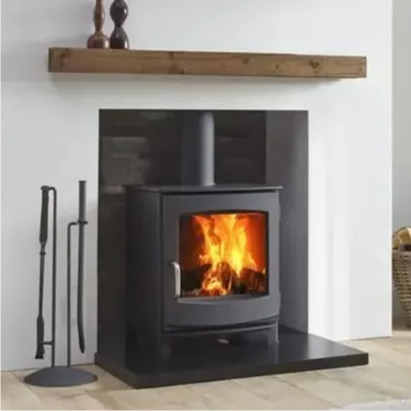 A Dik Geurts stove burning in a fireplace