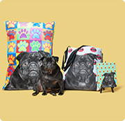 Black pug with a dog bed a tote bag and a journal
