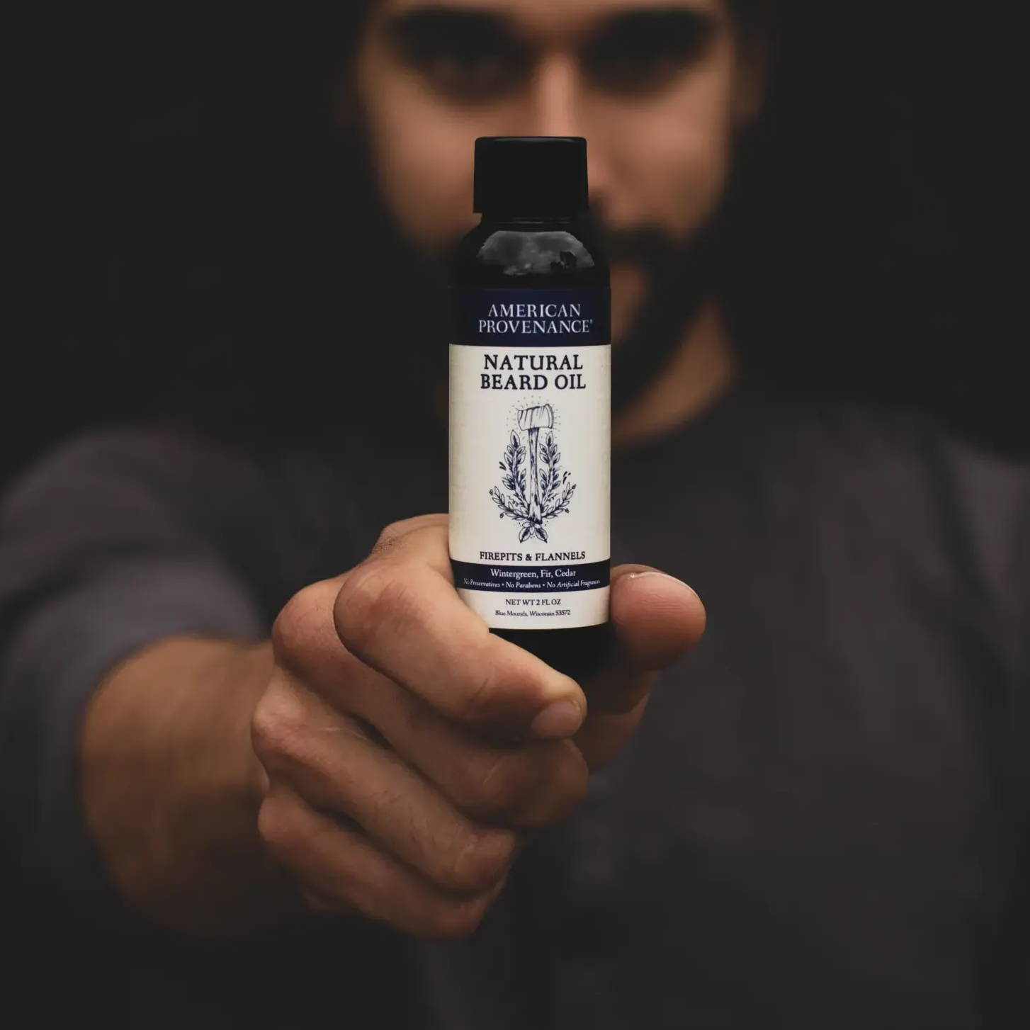 man holding beard oil