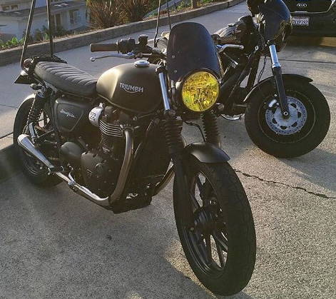 Triumph motorcycle with Yellow Lamin-x headlight tint film cover