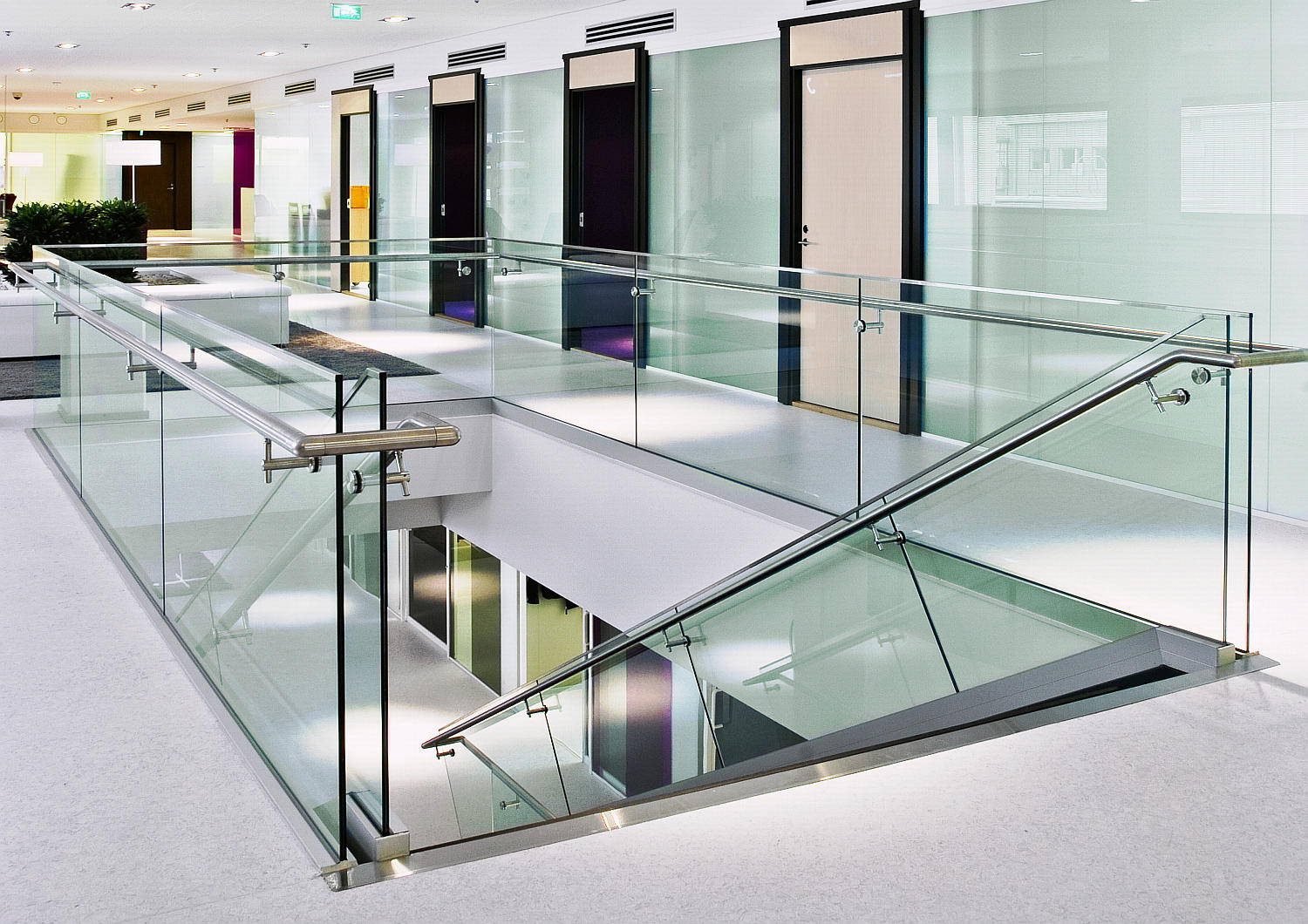 Glass handrails with metal railing