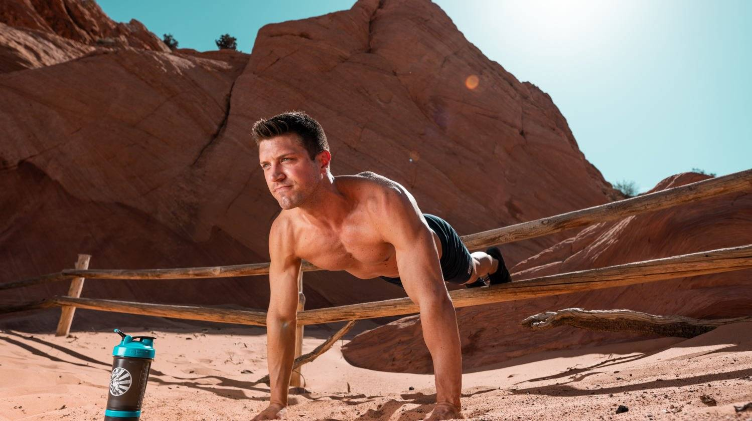 Ambassador Tommy Didario doing push up with feet elevated in the desert | The Best Protein Powder for Men | best protein powder for men weight loss | Featured