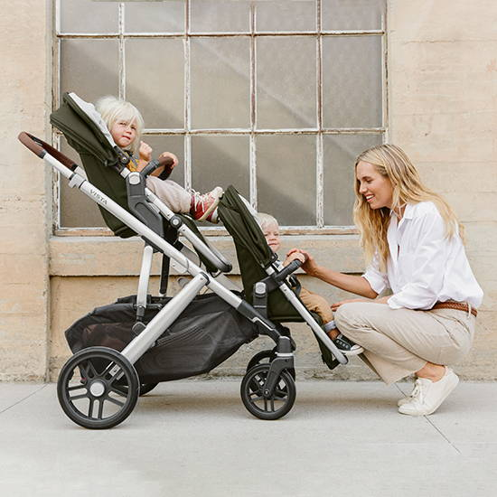 Uppababy Vista baby stroller, woman pushing two children in a stroller