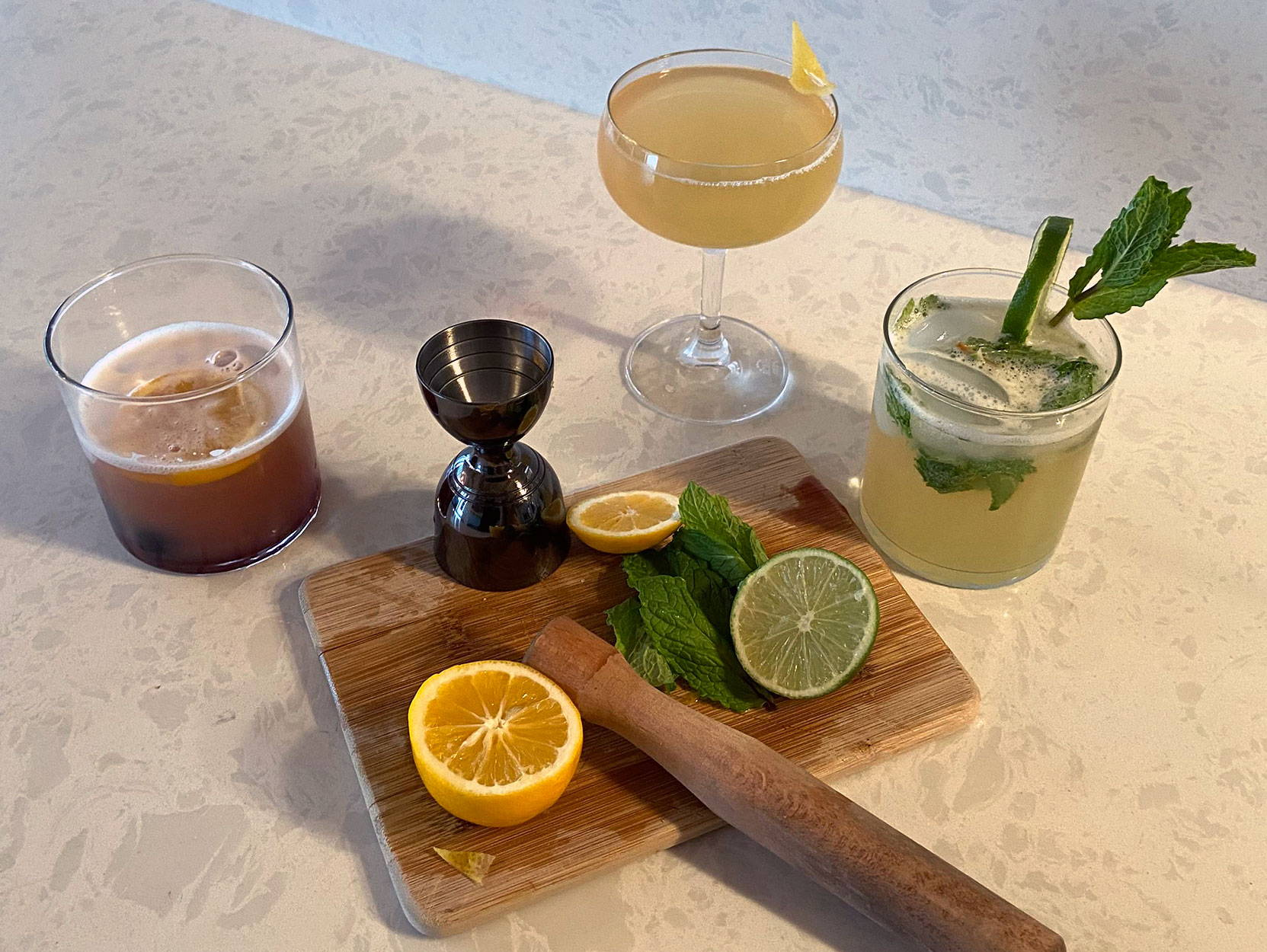 Some of our favorite international cocktails: a Singapore Sling, a French 75, and a Mojito