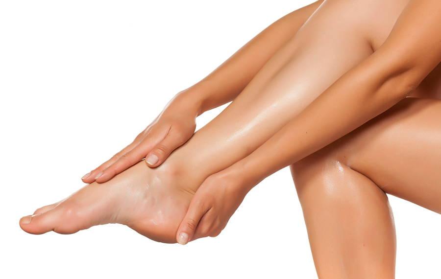 woman applying shea to her legs