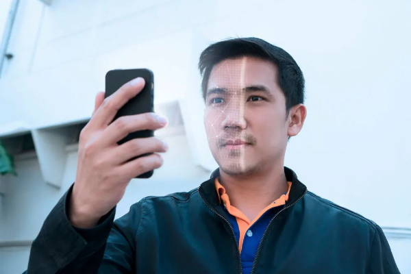 Man scanning facial features using phone