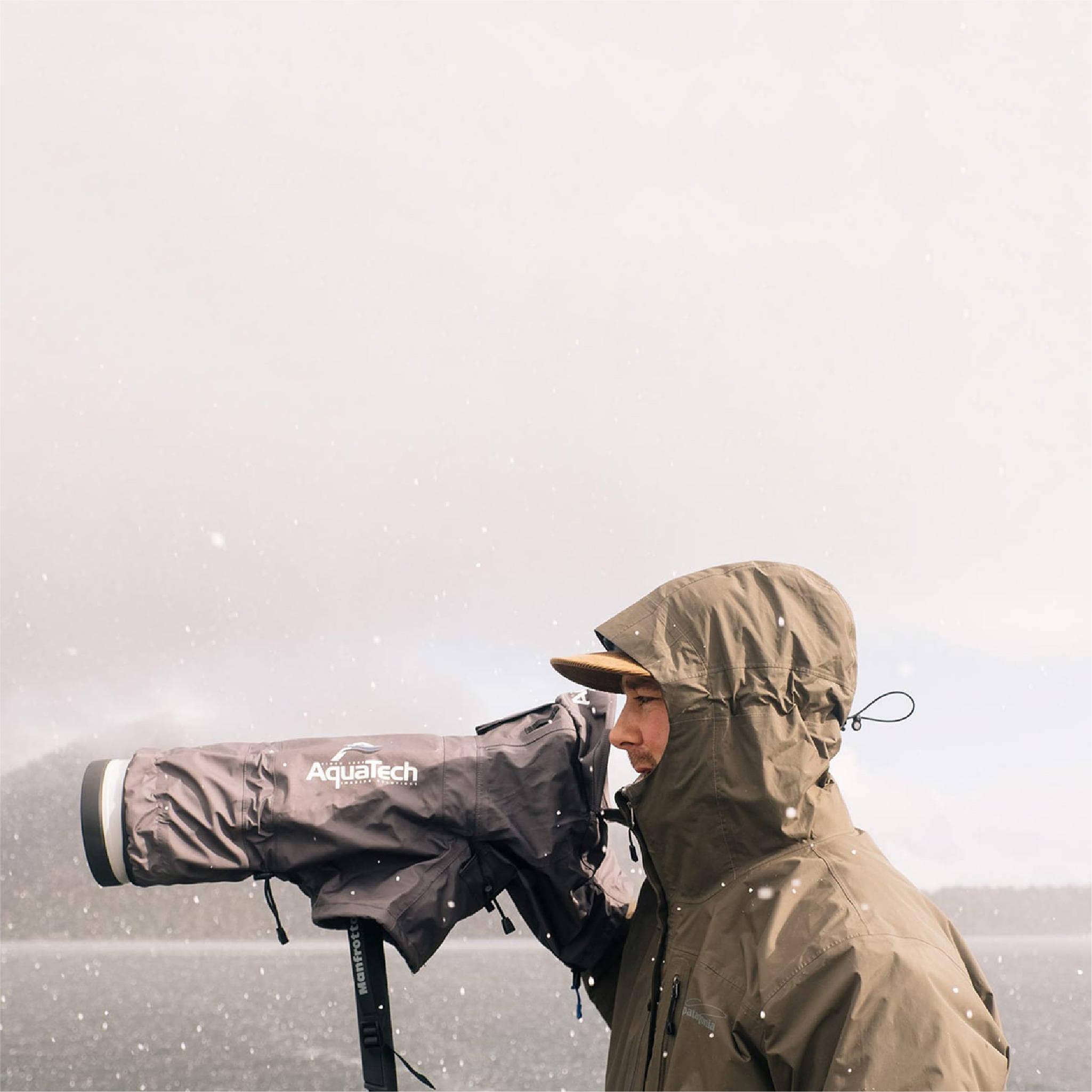 Jeremy Koreski looking through camera