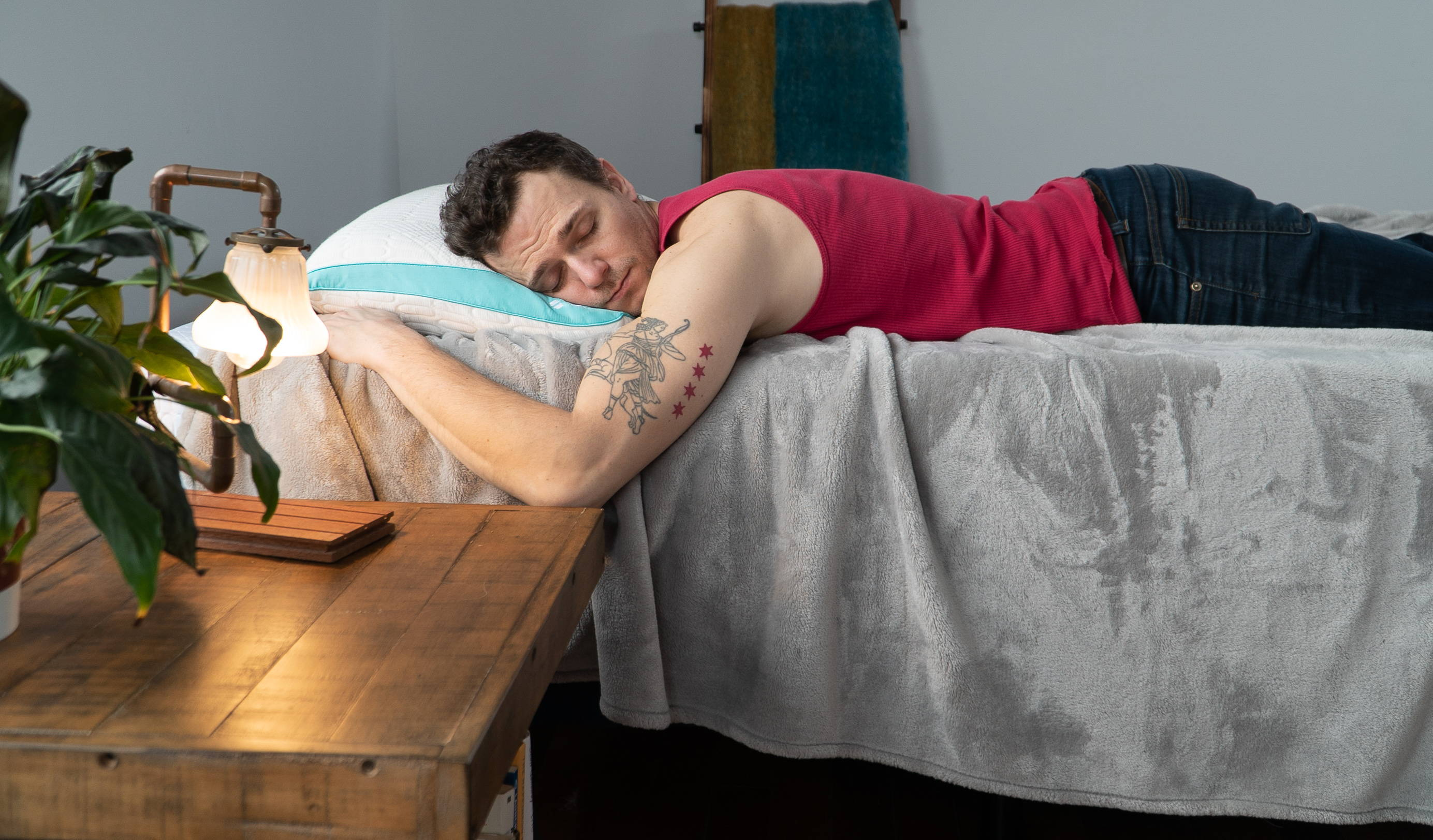 How to Sleep Better Guides. man sleeping on REM-Fit 500 cooling pillow