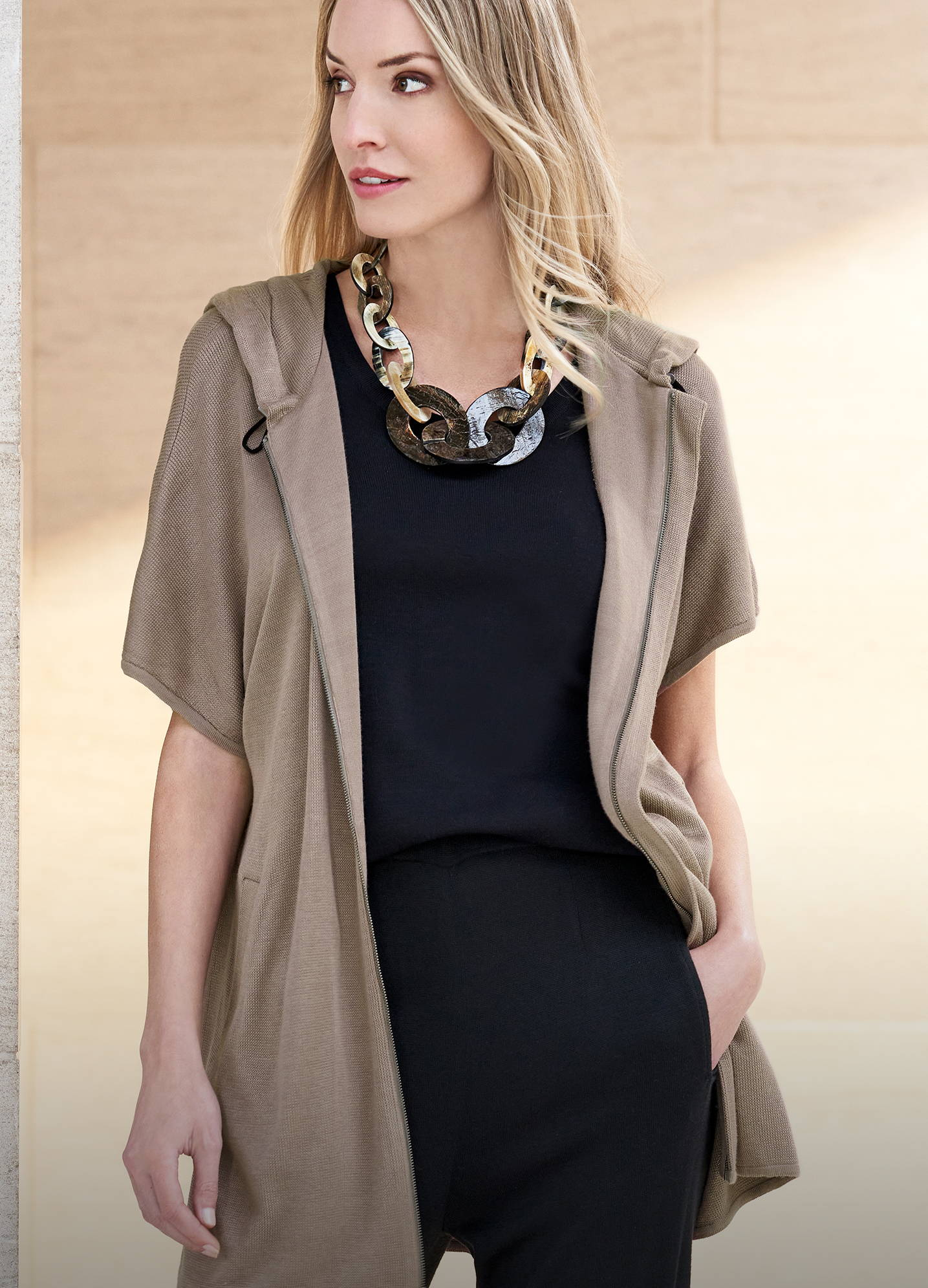 Shawl Collar Sheer Sleeve Knit Cardigan in Macchiato Paired with a Contrasting Classic Knit Tank Top and Knit Jogger Pant in Black