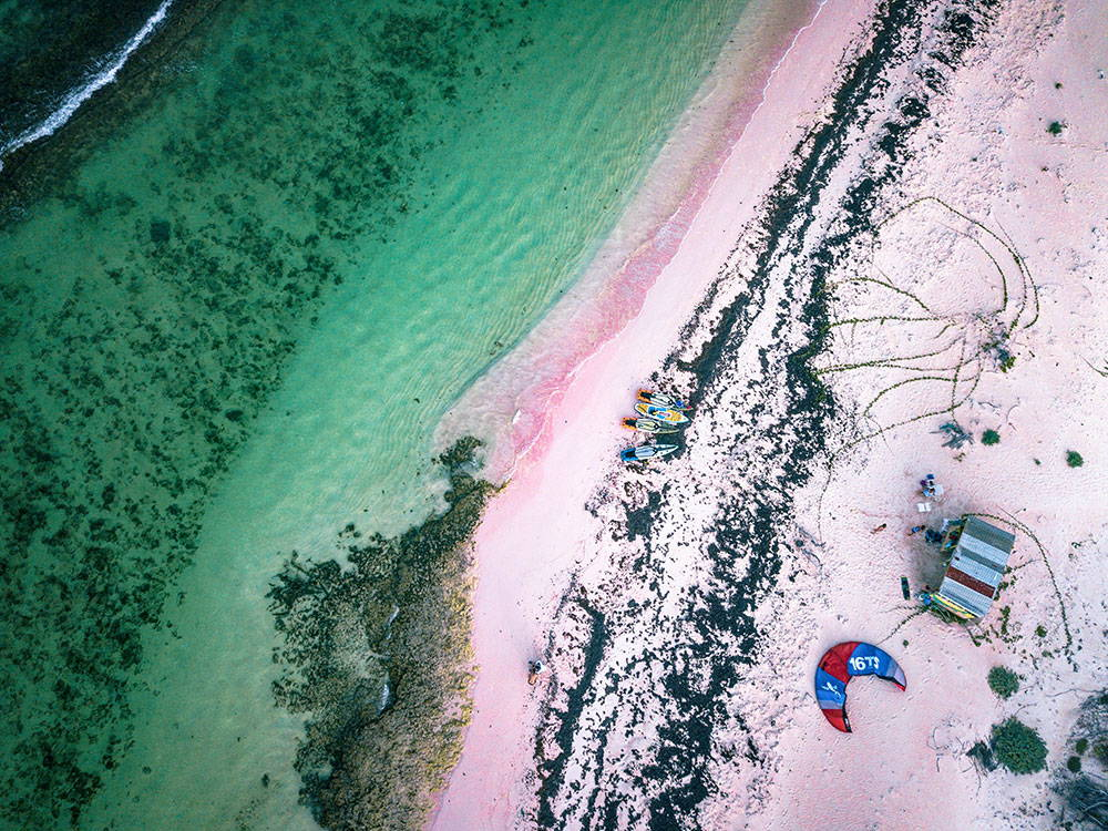 Arial view of SUP's on a beach