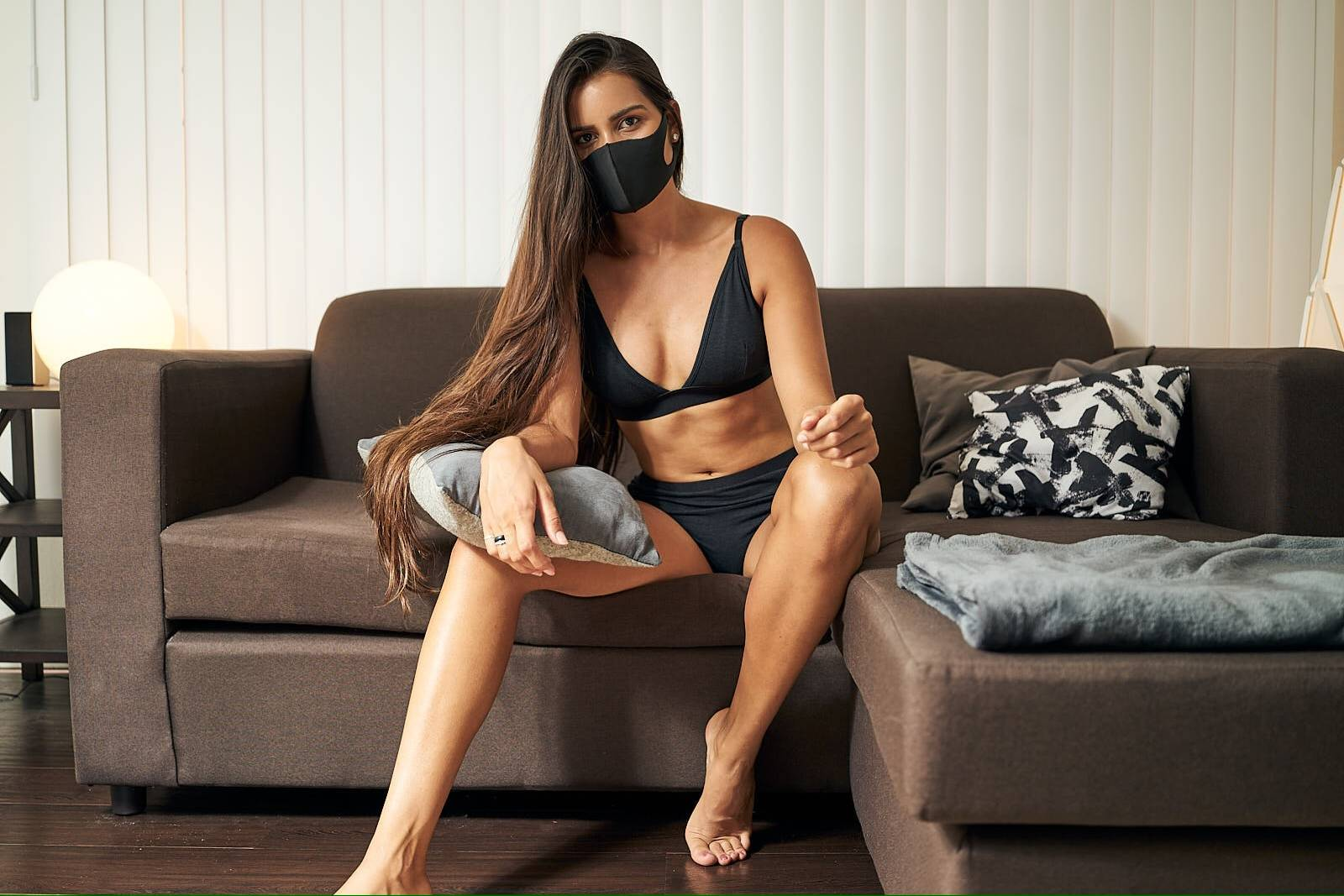 A woman wears a hemp face mask and organic underwear from WAMA.