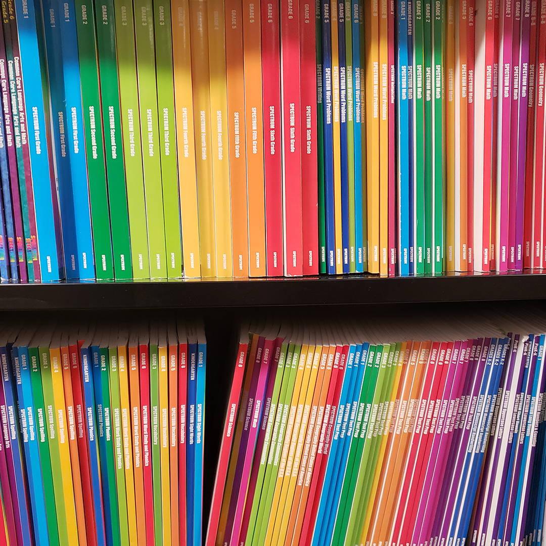 Spectrum books on a bookshelf