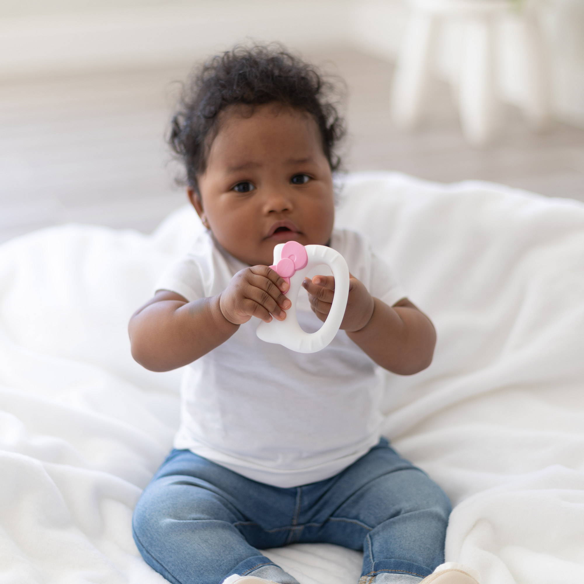 baby holding hello kitty silicone teething toy