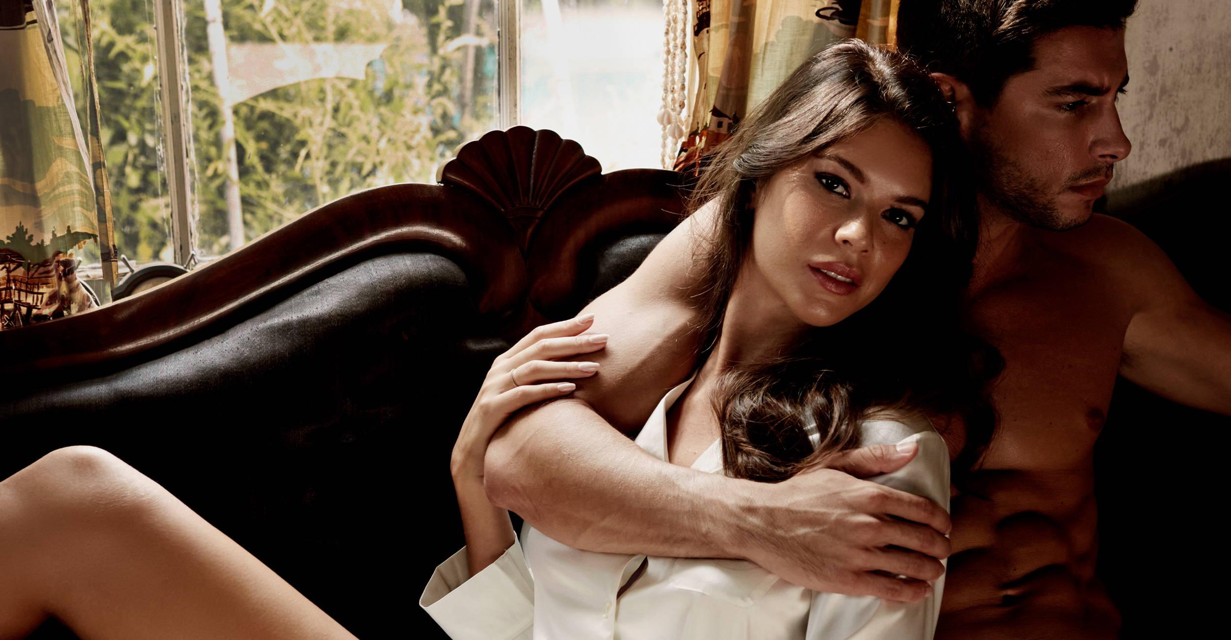 Female model wearing the Journelle Sophia Pajama Set next to male model
