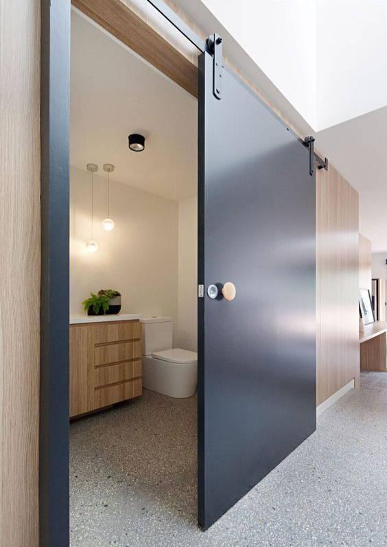 barn doors make a small space feel bigger