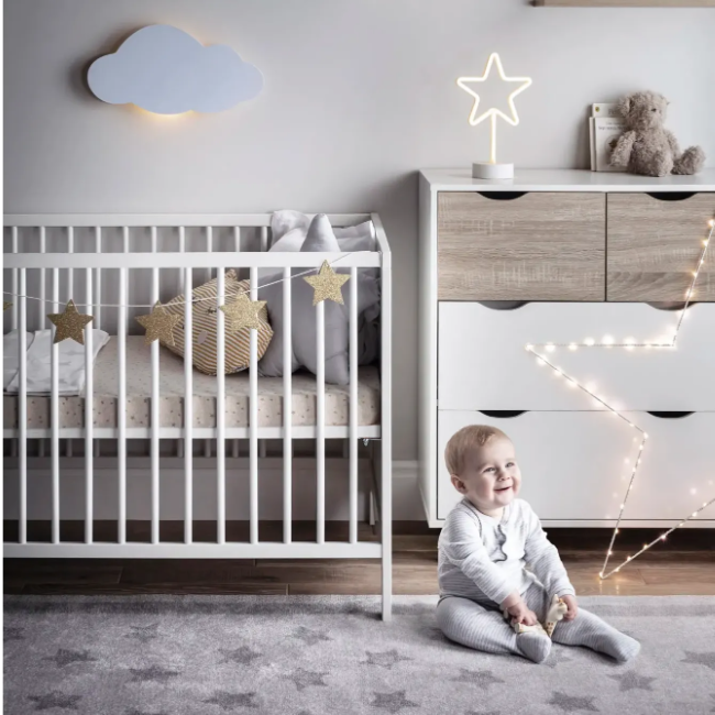 bedroom displaying a collections of indoor nursery lights