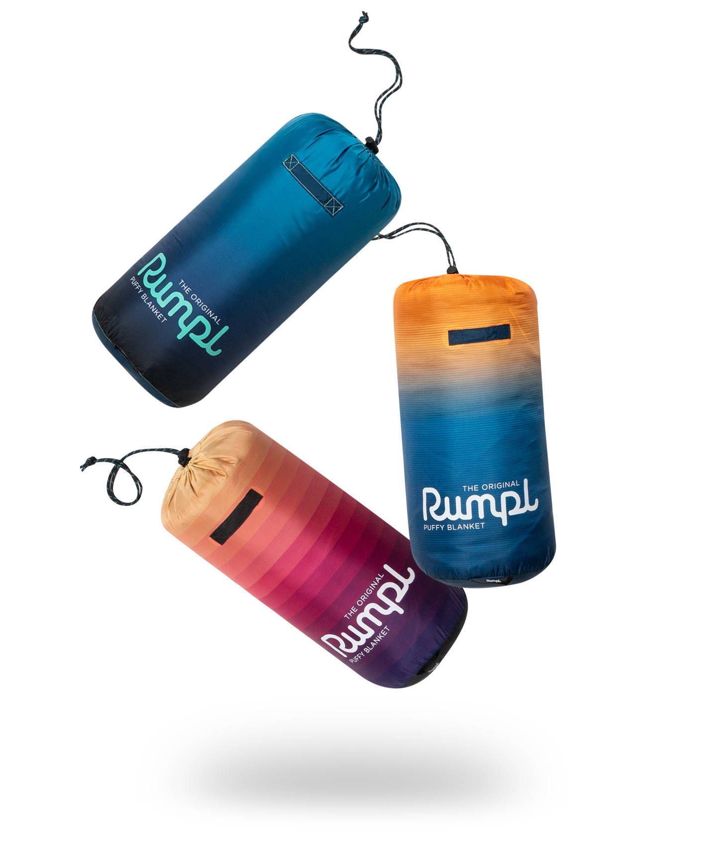 3 Rumpl Original Puffy Blankets floating in front of white background