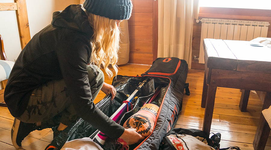 Amie Engerbretson packing her travel bag and packing her Rumpl down puffy blanket