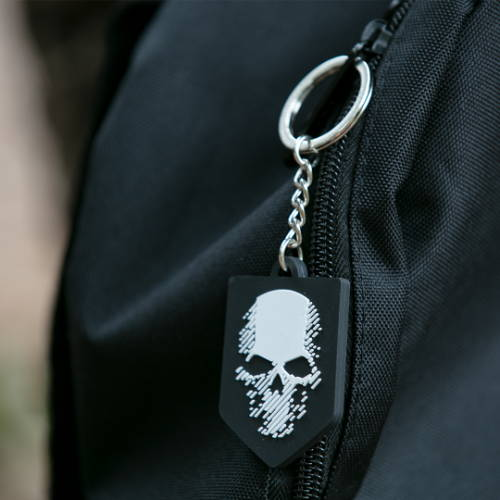 Photo showing a Ghost Recon key chain on a backack