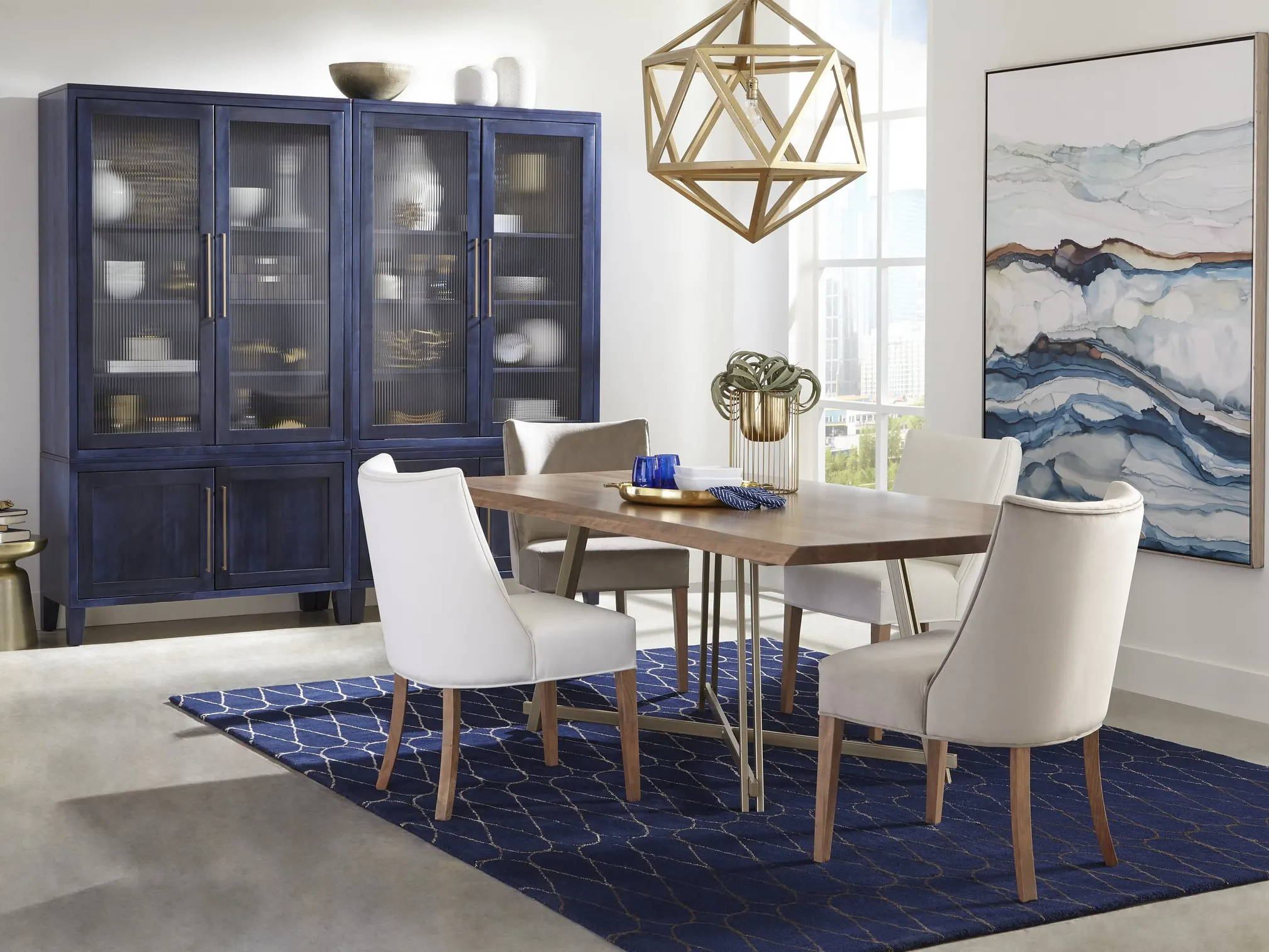 dining room scene with upholstered chairs around small table in front of large display cabinets