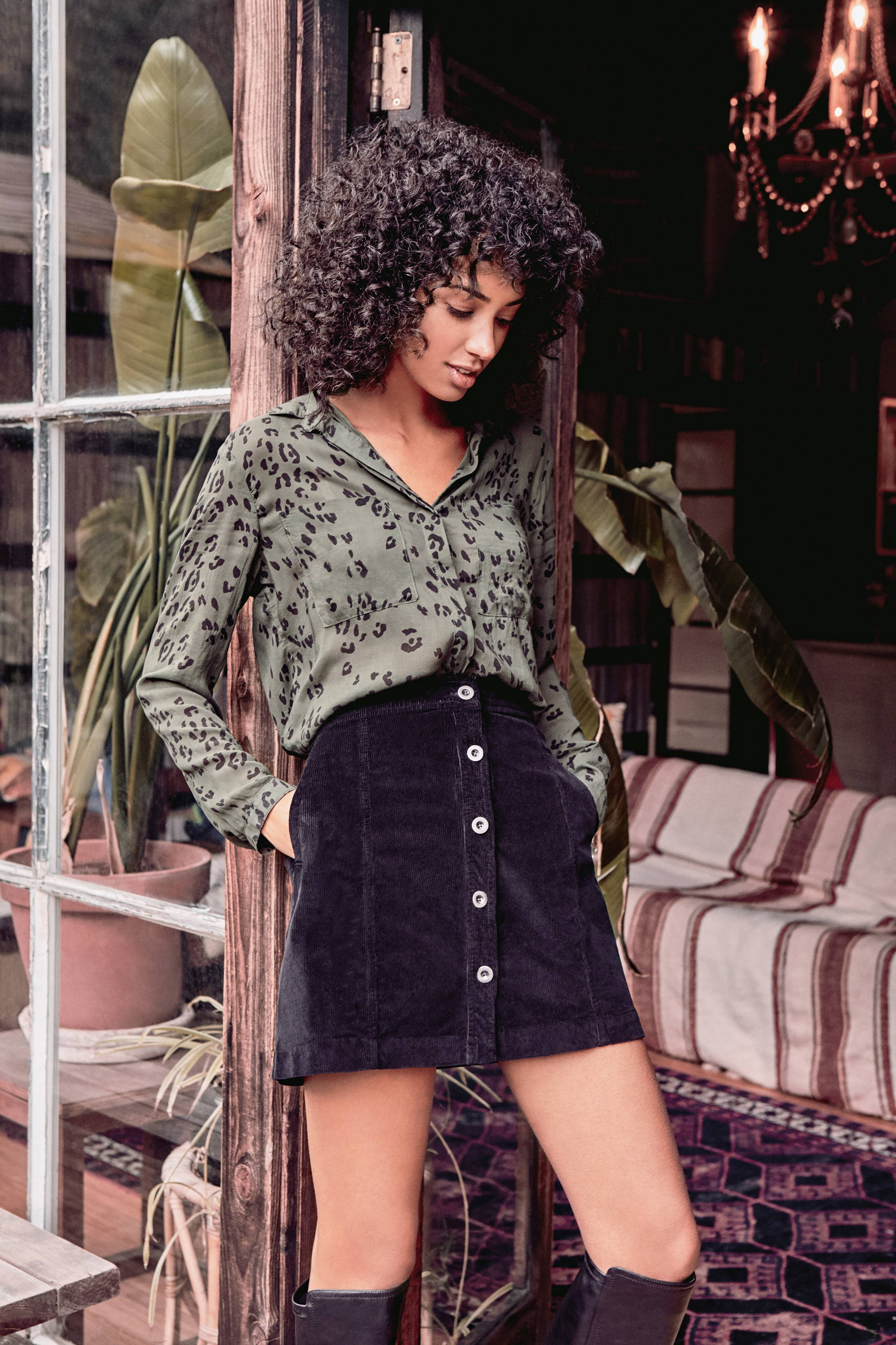 Womens Olive Leopard Print Long Sleeve Button Down Hipster Shirt With Front Pockets. Styled With Black Corduroy Skirt.