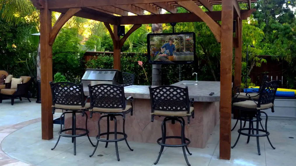 The TV Shield outdoor TV enclosure under cabana is weatherproof