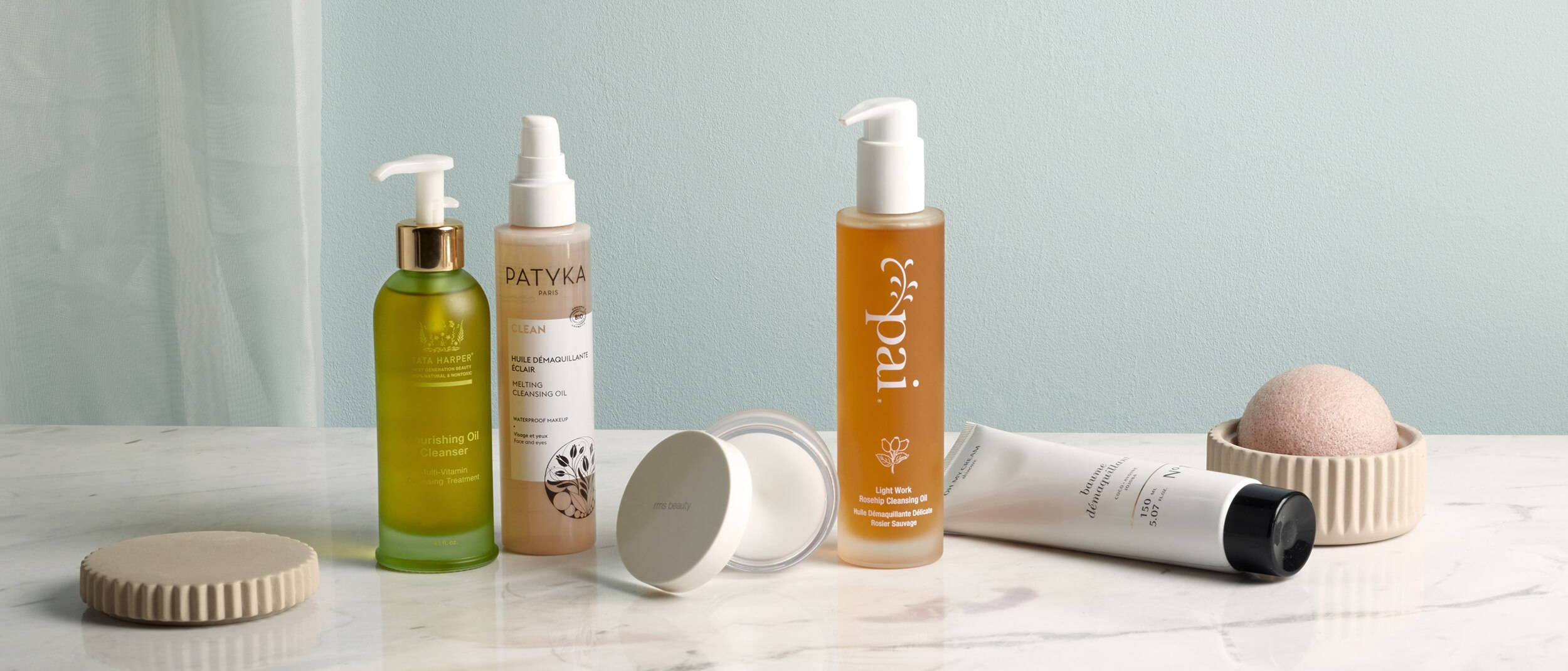 Nourishing Cleansing oil Tata Harper, Huile démaquillante éclair Patyka, Huile démaquillante délicate rosier sauvage Pai Skincare, Baume démaquillant Oh My Cream Skincare