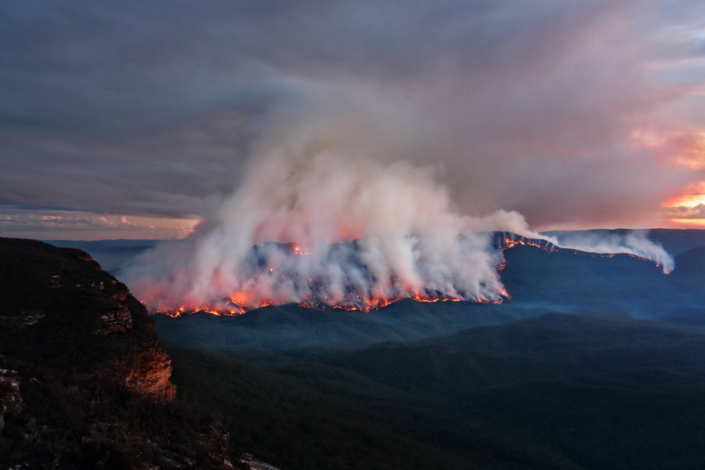 mt solitary burns at dusk from australian bushfire