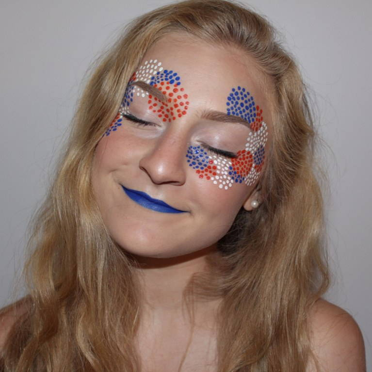 Celebrate the night early by bringing the fireworks on during the day. This look can be done with makeup, or face paint, so your options are unlimited.